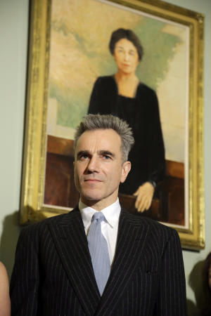 "Cast member Daniel Day-Lewis stands in front of a portrait of Sen. Hattie Caraway from Arkansas, during a media availability before a screening of the movie ""Lincoln,"" for members of Congress, on Capitol Hill Wednesday, Dec. 19, 2012 in Washington. (AP Photo/Alex Brandon)"