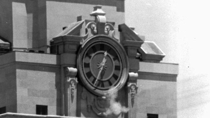 "FILE - In this Aug. 1, 1966 file photo, smoke rises from a sniper's gun as he fires from the tower of the University of Texas administration building in Austin, Texas at people below. Grant Duwe, a criminologist with the Minnesota Department of Corrections, says, ""Mass shootings provoke instant debates about violence and guns and mental health and that's been the case since Charles Whitman climbed the tower at the University of Texas in 1966."" The engineering student and former Marine killed 13 people and an unborn child and wounded 32 others in the shooting. (AP Photo/File)"