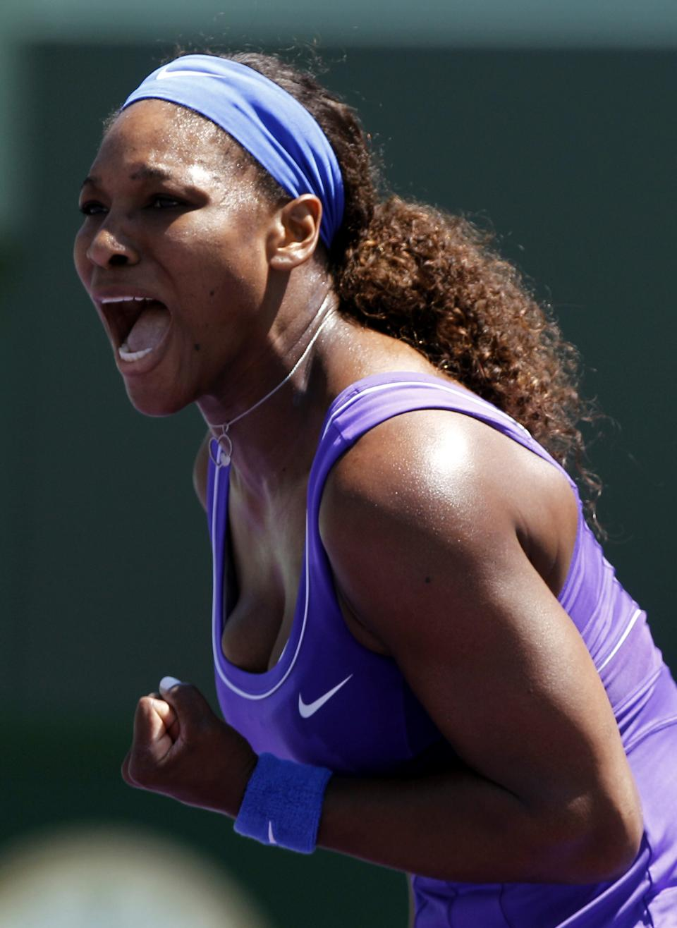 Serena Williams reacts after winning a point in the first set against Samantha Stosur, of Australia, during the Sony Ericsson Open tennis tournament, Monday, March 26, 2012, in Key Biscayne, Fla. (AP Photo/Lynne Sladky)
