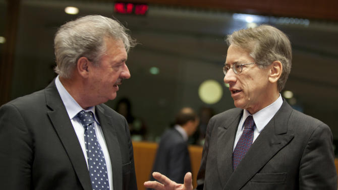 Luxembourg's Foreign Minister Jean Asselborn, left, speaks with Italian Foreign Minister Guilio Terzi di Sant'Agata during a meeting of EU foreign ministers at the EU Council building in Brussels on Monday, Dec. 10, 2012. The 27 EU foreign ministers will discuss the situation in Syria, where activists say more than 40,000 people have died. (AP Photo/Virginia Mayo)