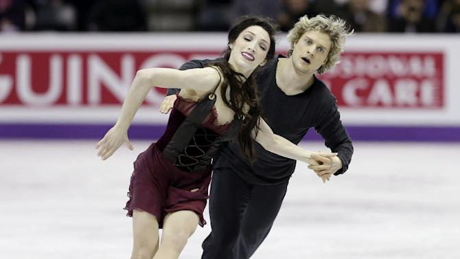 Meryl Davis and Charlie White, of the United States, perform during the free skate program in the ice dancing competition at the World Figure Skating Championships Saturday, March 16, 2013, in London, Ontario. (AP Photo/Darron Cummings)