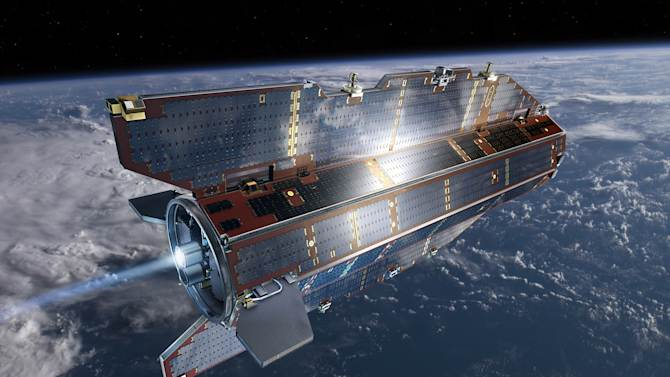 """In his image, publicly provided by the European Space Agency ESA, research satellite GOCE flies above earth. The European Space Agency says its GOCE research satellite will crash to Earth on Sunday night Nov. 10, 2013, most likely over the ocean or polar regions. Spokeswoman Jocelyne Landeau said the satellite will mostly disintegrate as it comes down and """"we will have only a few pieces which could be 90 kilograms at the most."""" The crash is expected to occur between 19:30 and 1:30 Central European Time from Sunday to Monday night. ESA said Friday that humans are 250,000 times more likely to win the lottery than to get hit by the debris that may survive the breakup. GOCE was launched in 2009 to map the Earth's gravitational field. It ran out of fuel last month, ending the mission. (AP Photo/European Space Agency,ESA) MANDATORY CREDIT"""