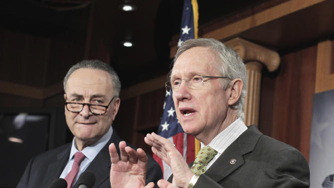 Senate Majority Leader Harry Reid of Nev., right, accompanied by Sen. Charles Schumer, D-N.Y.,  chairman of the Democratic Policy Committee, gestures during a news conference on Capitol Hill in Washington, Wednesday, March 2, 2011. (AP Photo/J. Scott Applewhite)
