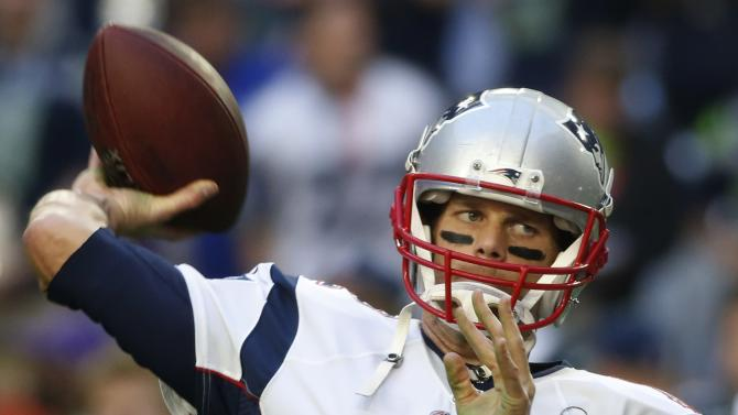 New England Patriots quarterback Tom Brady warms-up ahead of the start of the NFL Super Bowl XLIX football game against the Seattle Seahawks in Glendale