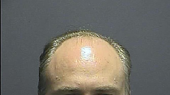 This photo provided by the Howard County (Md.) Police Dept. shows Michael McKenny. Howard County Police have arrested McKenny, a 42-year-old man they say secretly videotaped two women in their Ellicott City condominium, Thursday, Oct. 18, 2012. (AP Photo/Howard County (Md.) Police Dept.)
