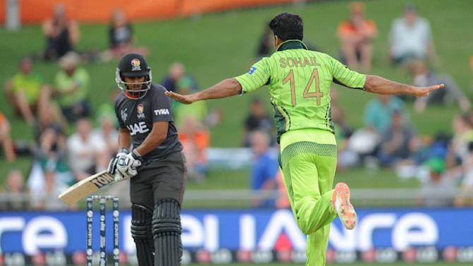 Pakistan bowler Sohail Khan, right, celebrates after taking the wicket of United Arab Emirates batsman Andri Raffaelo, left, during their Cricket World Cup Pool B match in Napier, New Zealand, Wednesday, March 4, 2015. (AP Photo Ross Setford)