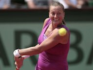 Czech Republic&#39;s Petra Kvitova hits a return to Russia&#39;s Nina Bratchikova during their French Open match at the Roland Garros stadium in Paris. Kvitova reached the last 16 for the third time but she did it the hard way, serving up eight double faults and committing 37 unforced errors in her 6-2, 4-6, 6-1 win