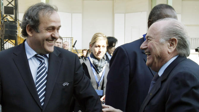 UEFA president Michel Platini of France, left, and FIFA president Sepp Blatter, right, joke during a break of the 35th Ordinary UEFA Congress at the Grand Palais in Paris, France, Tuesday, March 22, 2011.  (AP Photo/ Francois Mori)
