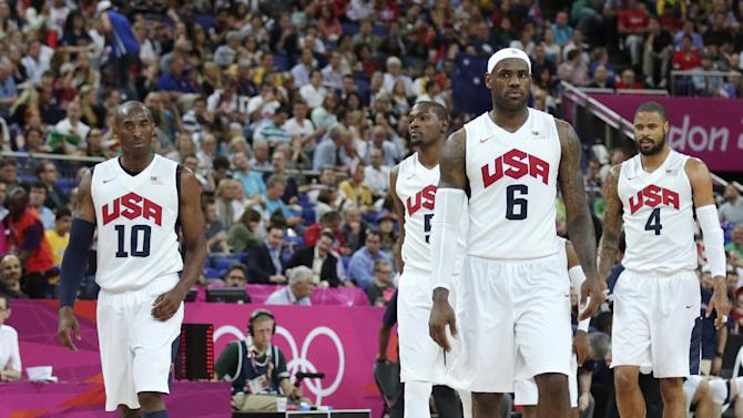 USA's Lebron James (6) walks up the court with teammates Kobe Bryant (10), Kevin Durant (5) and Tyson Chandler (4) during a men's quarterfinals basketball game against Australia at the 2012 Summer Olympics, Wednesday, Aug. 8, 2012, in London. (AP Photo/Charles Krupa)