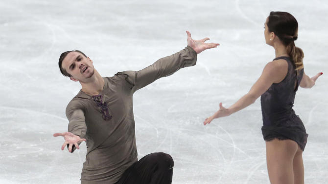 Ksenia Stolbova and Fedor Klimov, of Russia, end their free program at the European Figure Skating championships in Stockholm, Sweden, on Sunday, Feb. 01, 2015. (AP Photo/Ivan Sekretarev)