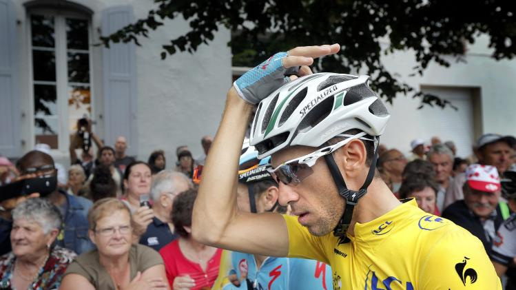 Race leader and yellow jersey holder Nibali arrives at the start line before the 19th stage of theTour de France cycling race