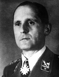"FILE - Undated b/w file picture of former German Gestapo head Heinrich Mueller. For decades there were alleged sightings of Mueller in Cuba, Argentina and elsewhere. But Johannes Tuchel, director of Berlin's German Resistance Memorial Center, said Thursday Oct. 31, 2013 he's uncovered evidence Mueller didn't make it out of Berlin. He says several documents, including a 1945 death certificate and a grave digger's testimony to police in 1963, make it ""clear-cut"" to him that Mueller died and was buried near the Luftwaffe headquarters in the final days of the war. He says Mueller was later disinterred and buried with thousands others in a common grave in a Jewish cemetery destroyed by the Nazis. (AP-Photo,File)"