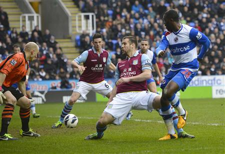 Reading's Hope Akpan scores against Aston Villa during their English Premier League soccer match at The Madejski Stadium, Reading, southern England