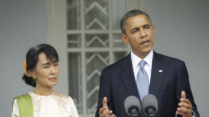 U.S. President Barack Obama, right, accompanied by Myanmar opposition leader Aung San Suu Kyi, addresses members of the media at Suu Kyi's residence in Yangon, Myanmar, Monday, Nov. 19, 2012. Obama who touched down Monday morning, becoming the first U.S. president to visit the Asian nation also known as Burma, said his historic visit to Myanmar marks the next step in a new chapter between the two countries. (AP Photo/Pablo Martinez Monsivais)