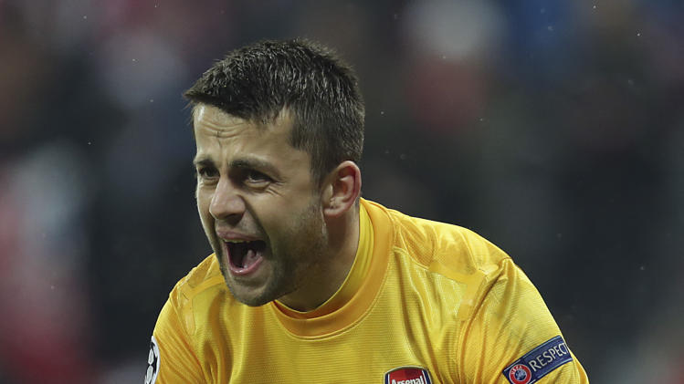 Arsenal's Lukasz Fabianski reacts during the Champions League round of 16 second leg soccer match between FC Bayern Munich and FC Arsenal in Munich, Germany, Wednesday, March 13, 2013. (AP Photo/Matthias Schrader)