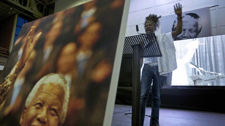A praise poet takes part in a service held in tribute of former South African President Mandela in Khayelitsha