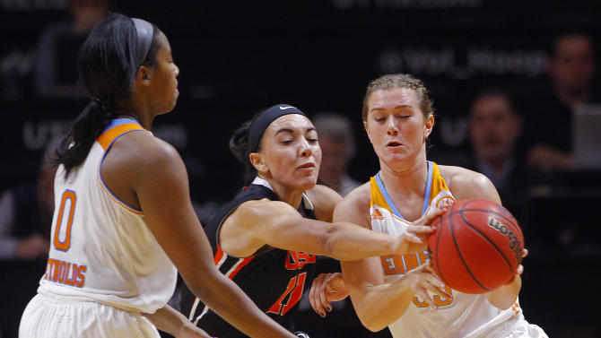 Oregon State guard Gabriella Hanson (11) attempts to steal the ball from Tennessee guard Alexa Middleton (33) as it is passed by Tennessee guard Jordan Reynolds (0) in the first half of an NCAA college basketball game Sunday, Dec. 28, 2014, in Knoxville, Tenn. (AP Photo/Wade Payne)