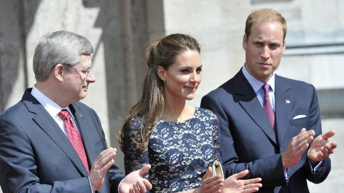 Prince William and wife Kate, the Duke and Duchess of Cambridge and Prime Minister Stephen Harper, left, take part in a ceremony ar Rideau Hall in Ottawa on Thursday, June 30, 2001. (AP Photo/The Canadian Press, Nathan Denette)
