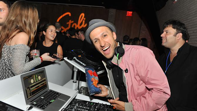 DJ VIce gets a taste of new Ruffles Ultimate Potato Chips at The MAXIM Hot 100 Party, Thursday, May 24, 2012, in New York.  (Diane Bondareff/AP Images for Ruffles Ultimate)