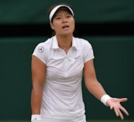 China's Li Na reacts during a match at the Wimbledon Championships in London, on July 2, 2013. The world number six, now a veteran at 31, has developed a reputation as a prickly character in a nation where sports stars typically keep their emotions strictly in check after years in the rigid state sports training system