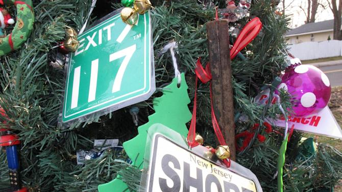 """A hand-made ornament adorns the """"Tree Of Hope,"""" shown here in Union Beach N.J. on Dec. 12, 2012. The artificial Christmas tree was fished from the gutter following Superstorm Sandy, and the town has made it a rallying point amid the storm's devastation. (AP Photo/Wayne Parry)"""