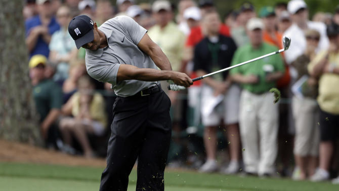 Tiger Woods hits on the first fairway during the first round of the Masters golf tournament Thursday, April 11, 2013, in Augusta, Ga. (AP Photo/Darron Cummings)