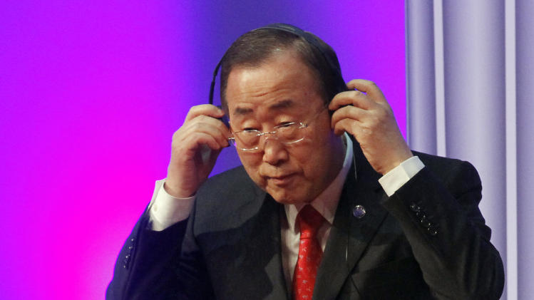 United Nations Secretary-General Ban Ki-moon adjusts his earphones during the inauguration ceremony of the King Abdullah Bin Abdulaziz International Centre for Interreligious and Intercultural Dialogue, KAICIID, in Vienna, Austria, Monday, Nov. 26, 2012. (AP Photo/Ronald Zak)