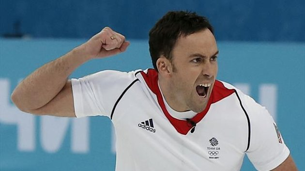 Britain's skip David Murdoch celebrates after winning their men's curling semi-final game against Sweden (Reuters)