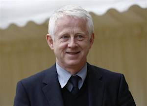 Director Richard Curtis arrives for a reception for the British Film Industry held by Britain's Queen Elizabeth and Prince Philip at Windsor Castle, southern England