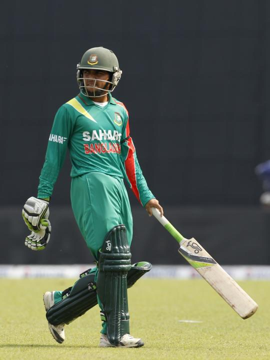 Bangladesh's Mominul Haque leaves the field after being dismissed against New Zealand during their first ODI cricket match in Dhaka