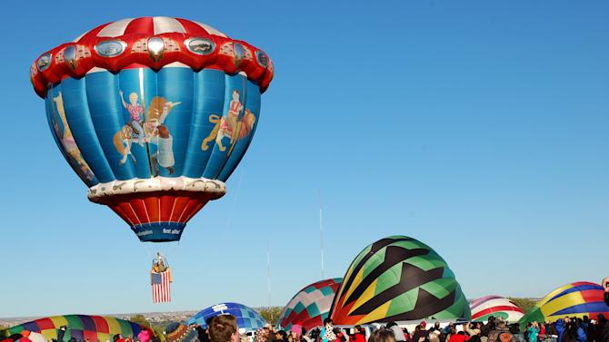 "In this Oct. 8, 2011 photo, the ""Carousel"" hot air balloon is shown at the Albuquerque International Balloon Fiesta. The 41st annual event is set to begin Saturday and is expected to draw hundreds of thousands of spectators from around the country and the global. (AP Photo/Russell Contreras)"