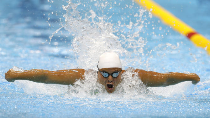 South Africa's Natalie du Toit competes in the women's 100m Butterfly S9 category at the 2012 Paralympics Olympics, Thursday, Aug. 30, 2012, in London. (AP Photo/Kirsty Wigglesworth)