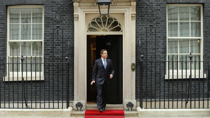 Britain's Prime Minister David Cameron walks out to greet the President of Singapore Tony Tan at Number 10 Downing Street in London