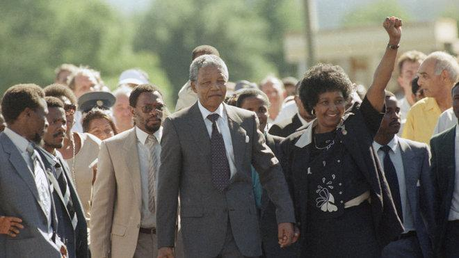 Nelson Mandela and his wife walk together after he is released from ...