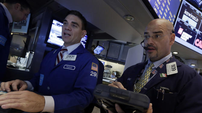 Specialist Robert Tuccillo, left, and trader Luigi Muccitelli work on the floor of the New York Stock Exchange Monday, Sept. 16, 2013. U.S. stocks and bonds are rising sharply in early trading after former Treasury Secretary Larry Summers withdrew from the race to become head of the Federal Reserve. (AP Photo/Richard Drew)