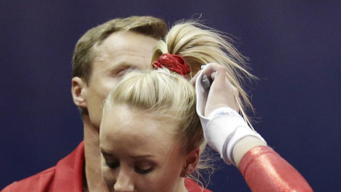 Nastia Liukin reacts after competing on the uneven bars during the final round of the women's Olympic gymnastics trials, Sunday, July 1, 2012, in San Jose, Calif. (AP Photo/Jae C. Hong)