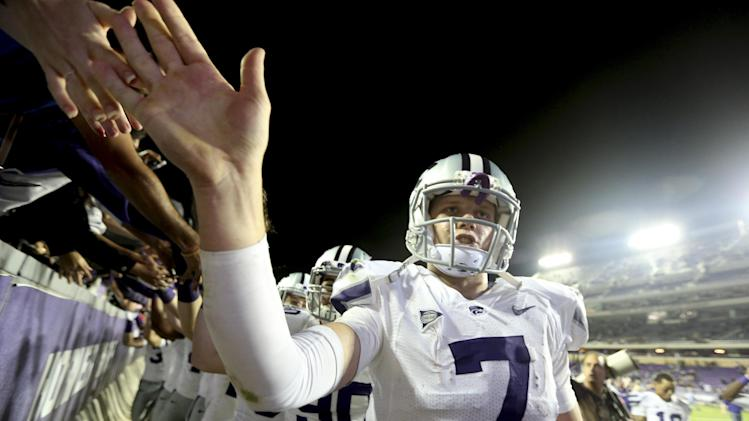 Kansas State quarterback Collin Klein (7) celebrates with fans in the stands after the NCAA college football game against TCU, Saturday, Nov. 10, 2012, in Fort Worth, Texas. Klein ran for two touchdowns and No. 3 K-State bolstered its BCS national title hopes with a 23-10 victory at Big 12 newcomer TCU. (AP Photo/LM Otero)
