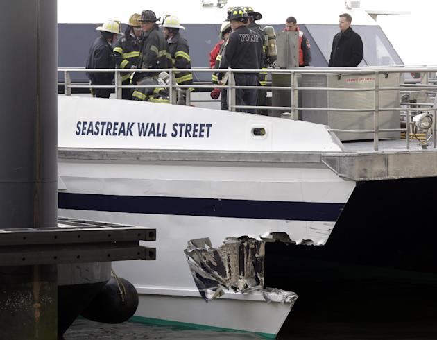New York City firefighters walk the deck of the Seastreak Wall Street ferry in New York,  Wednesday, Jan. 9, 2013. The ferry from Atlantic Highlands, N.J., banged into the mooring as it arrived at Sou
