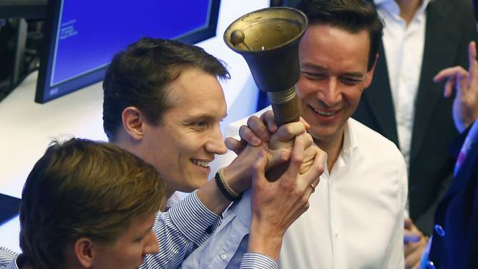Samwer, CEO of Rocket Internet, a German venture capital group, Kudlich, member of the management board and CFO Kimpel ring a bell during the initial public offering at the Frankfurt stock exchange October 2, 2014.