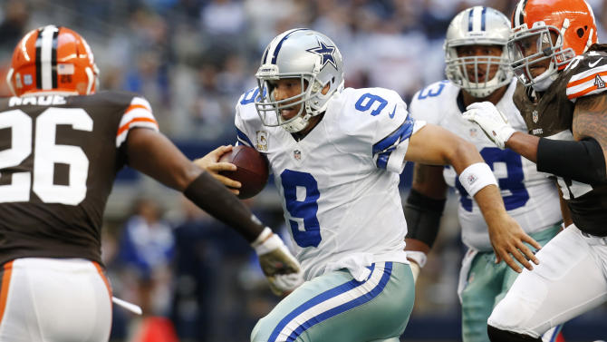 Cleveland Browns' Trevin Wade (26) and Jabaal Sheard (97) close in on Dallas Cowboys quarterback Tony Romo (9) in the second half of an NFL football game, Sunday, Nov. 18, 2012, in Arlington, Texas. (AP Photo/Sharon Ellman)