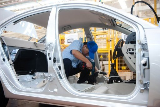 <p>Workers assemble a car in the Chang'an automobile factory in Beijing in August 2012. President Barack Obama will launch a new WTO enforcement action against Chinese auto subsidies Monday, countering his Republican foe Mitt Romney's accusations that he is too timid towards Beijing.</p>