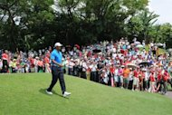 US golfer Tiger Woods walks through the first hole during the first round of the CIMB Classic golf tournament in Kuala Lumpur on October 25