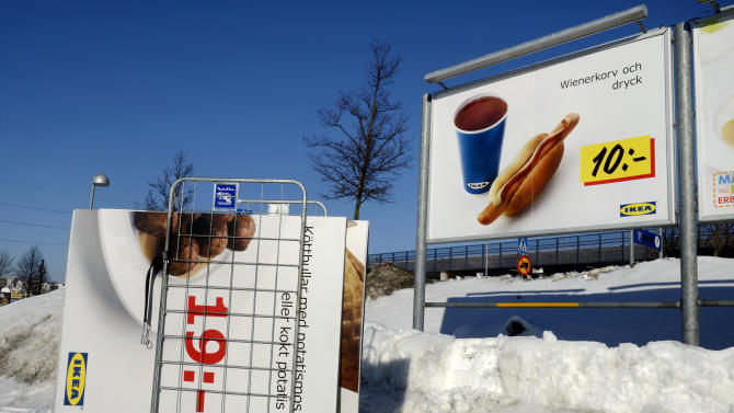 Advertising billboards for Ikea meat balls are taken down from a parking at the Ikea store in Stockholm, Sweden, Monday, Feb. 25, 2012. Swedish furniture giant Ikea was drawn into Europe's widening food labeling scandal Monday as authorities in the Czech Republic said they had detected horse meat in frozen meatballs labeled as beef and pork and sold in 13 countries across the continent. (AP Photo/Jessica Gow) SWEDEN OUT