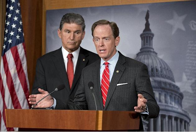 FILE - In this April 10, 2013 file photo, Democratic Sen. Joe Manchin of West Virginia, left, and Republican Sen. Patrick Toomey of Pennsylvania, right, announce that they have reached a bipartisan de