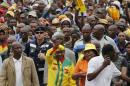 Lesotho's Prime Minister and leader of the All Basotho Convention Thomas Thabane waves to his supporters during his walkabout in the capital Maseru