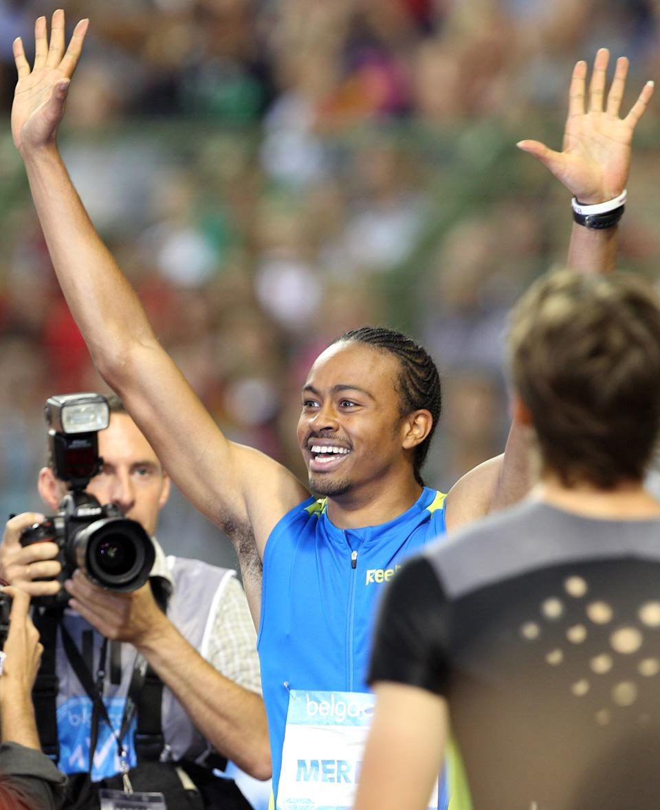 US athlete Aries Merritt celebrates winning the 110 meters hurdles and breaking a new world record at the Diamond League Memorial Van Damme athletics event at Brussels' King Baudouin Stadium, Friday, Sept. 7, 2012. (AP Photo/Yves Logghe)
