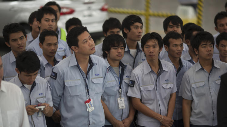 Thai Ford Manufacturing employees look on Friday, Aug. 31, 2012, during ceremony to showcase the 350 millionth produced Ford Focus at the Ford Motor Company factory in Rayong, Thailand.  (AP Photo/str)