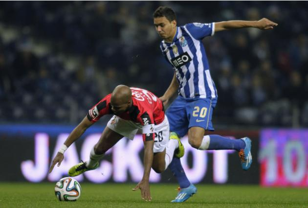 Porto's Carlos Eduardo battles for the ball with Olhanense's Celestino during their Portuguese Premier League soccer match at Dragao stadium in Porto