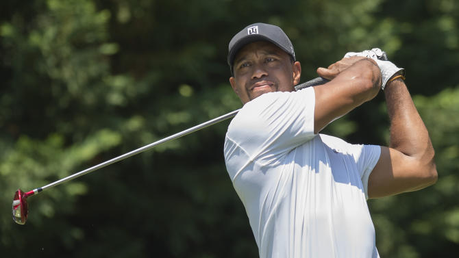 US golfer Tiger Woods tees off during the second round of the Quicken Loans National at Congressional Country Club in Bethesda, Maryland, on June 27, 2014