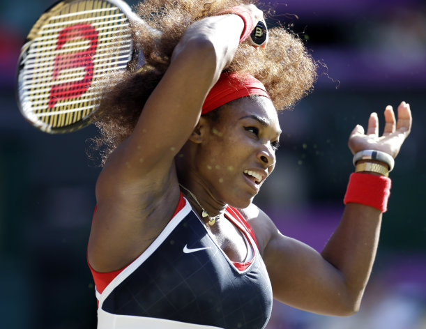Serena Williams of the United States returns to Victoria Azarenka of Belarus at the All England Lawn Tennis Club in Wimbledon, London at the 2012 Summer Olympics, Friday, Aug. 3, 2012. (AP Photo/Elise Amendola)